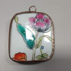 Pretty enameled flower pendant